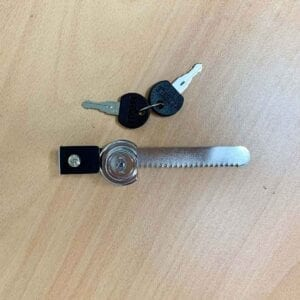 black and chrome lock with 2 keys on a timber background