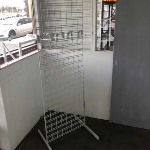 white retail slat grid stand with display hooks